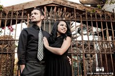 Old Town engagement shoot of couple standing at gate