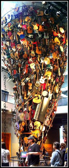 """The cool guitar art installation at the EMP Museum in Seattle. Find out more at """"Down the Wrabbit Hole - The Travel Bucket List"""". Click the image for the blog post."""