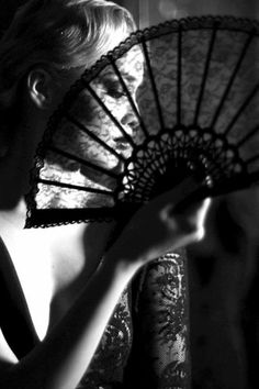 the beauty & mystique of females behind veils/masks/fans