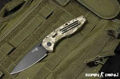 "SOG Aegis - Digi-Camo/Black-Tini. Total Length: 8.25"" Blade Length: 3.5"" Weight: 3.10oz. Blade Thickness: .13"" Steel Type: AUS-8. Photo Credit: Zorin Denu."