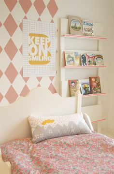muted pink diamonds just behind the bed- great for little girls