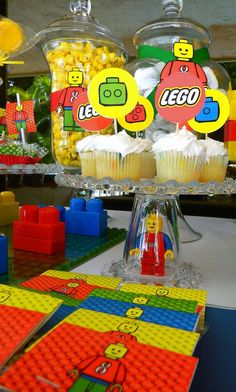 Lego Party | CatchMyParty.com -- Lego mini figure in upside down glass as a cake stand stem