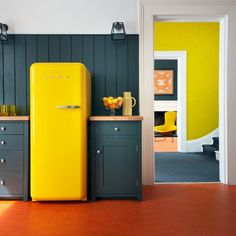 Lemon yellow vintage/retro fridge, wall and chair.  Great display of depth and wonderful pop of color.
