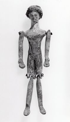 Museum number 1852,0707.7 / Description Mould-made terracotta doll; red and white slip. / Date 4thC BC(early) /  Production place Made in: Corinthia(Europe,Greece,Peloponnese,Corinthia) / DimensionsLength: 15 centimetres