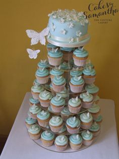 A small white butterfly sits atop each cupcake, and larger dainty butterflies flit around the flowered cake topper.  This design is so delightfully reminiscent of spring you can't help smiling.