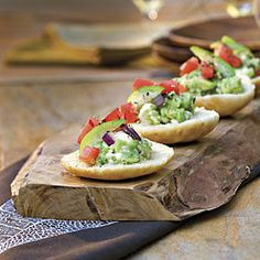 Guacamole-Goat Cheese Toasts  Upgrade the traditional bowl of guac by serving pre-portioned servings on edible platters. A dollop of zesty guacamole on top of a miniature pita round creates an appetizer that's both attractive and delicious—a winning combination on any night.