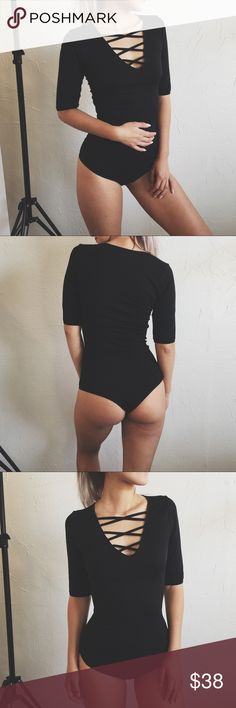"""• Society Vol. 3 Bodysuit • Quarter sleeve black Bodysuit with criss cross detailing. • If you have any general questions about shopping with me please see my """"FAQ's & Closet Info"""" listing - If you would like to be notified of my new arrivals and restocks tag yourself in """"My Updates List • Revolt Society Other"""