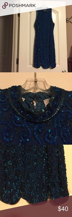 Absolutely gorgeous sequined formal Royal blue & black sequins, black rayon fabric, 100% pure silk lining, back zipper, 2 clasp closure at the neck, scalloped hem, kick pleat in back, size small Dresses