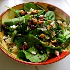 Delicious salad with spinach, brown rice, goat cheese, cranberries, basil, and cashews. My favorite!!