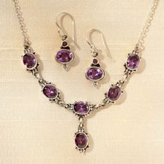 Faceted amethyst is complimented by sterling silver links in this jewelry set, handmade in Nepal by members of the Shakya clan. Newar Amethyst Earrings | National Geographic Store