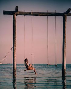"""""""Casually"""" swinging above the sea 🌊 Actually it was quite hard getting up there (I got a few laughters from the beach 🙈) Without the help of my love I wouldn't be swinging up there 😄😄 so thank you babe for always helping me a"""