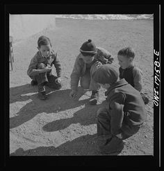 Trampas, New Mexico. Playing marbles in the dooryard of the home of Juan Lopez, the majordomo (mayor)