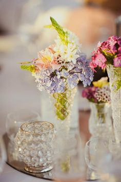 Posies tucked into lead crystal flutes add a touch of elegance...