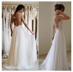 Backless flowing wedding gown