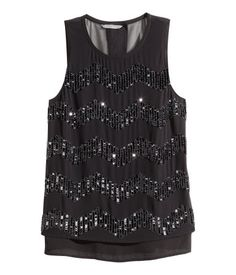 Black. Sleeveless blouse in chiffon with beads at front. Overlapping back section with buttons at back of neck. Chiffon lining.