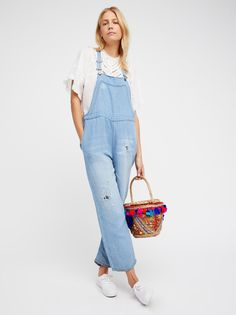 Destructive One Piece | In a linen-blend these washed overalls feature distressing details.    * Adjustable straps   * Side zipper closures   * Four-pocket style   * Slouchy fit