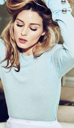 Who made Olivia Palermo's blue button sweater?