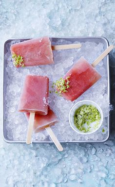Watermelon and lime daiquiri popsicles served with a zingy lime zest. These frozen cocktails are great for summer parties with friends and family!