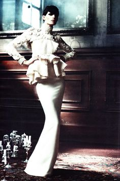 encrusted cut off over a white gown with a modest peplum.