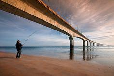 Le pêcheur et le pont - Rivedoux-Plage, Poitou-Charentes, France;  photo by Tony N., via Flickr