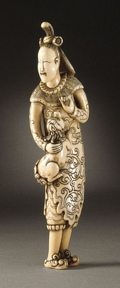 Japan  Chinese Woman and Dog, early 18th century  Netsuke, Ivory with staining, sumi, metal fitting