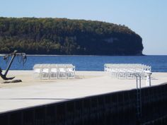 Small wedding chair set up on the pier at Bayview Resort & Harbor.  Check out that view of the Ellison Bay bluff!