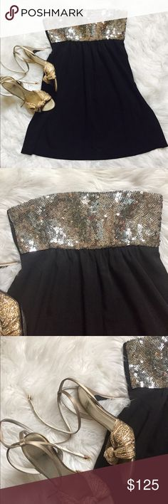 """Theory strapless New Years party dress Theory dress size 0.  Silver sequins on top.  The bust is about 13- 15 inches.  The waist is 16"""".  It hits above the knees. it's zippers on the side the shell is 87% will and and spandex lining is 91% silk Theory Dresses Strapless"""