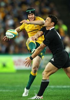 Berrick Barnes and Dan Carter during The Rugby Championship Bledisloe Cup match between the Wallabies and the New Zealand All Blacks