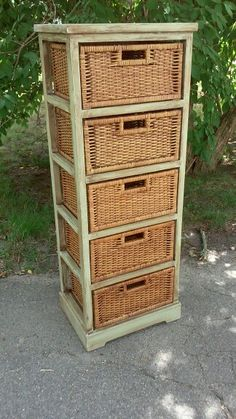 Wicker Basket Storage Unit. Painted with Waverly's celery colored chalk paint and sealed in dark antiquing wax