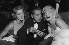Lauren-Bacall-Humphrey-Bogart-and-Marilyn-Monroe-at-the-premiere-of-How-to-Marry-a-Millionaire-1953.jpg 878×584 pixels