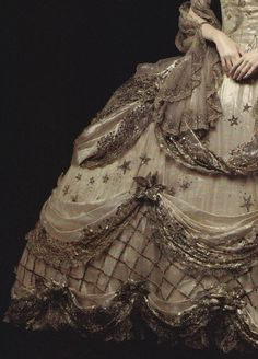 mademoisellelapiquante:  Costume designed by Adrian for Marie Antoinette - 1938 (detail, my scan)