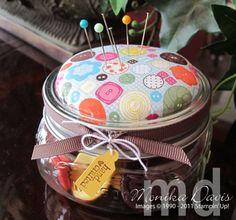 pin cushion on a button jar