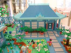LEGO 'zen garden'. oooh, love the soft colors used here. Could be tweaked into a Friends MOC :) love the sidewalk pavers