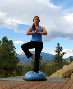 Yoga Tree Pose on the Bosu Ball. This one is very difficult on the floor! Imagine the instability that the Bosu Balance Trainer adds!