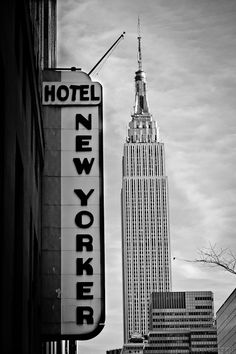 Hotel New Yorker Sign w Empire State Building in Back -  New York City