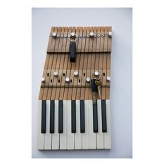 Key Rack Made from Recycled Piano Keys They are made from recycled keys from pianos that are beyond repair and renovation and have all the coverings, key and rail bushings and capstan screws as they. Piano Art, Piano Room, Piano Crafts, Old Pianos, Upright Piano, Key Rack, Piano Keys, Music Decor, Recycled Furniture