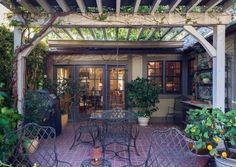 Traditional Patio with Outdoor kitchen, French doors, exterior brick floors, Trellis