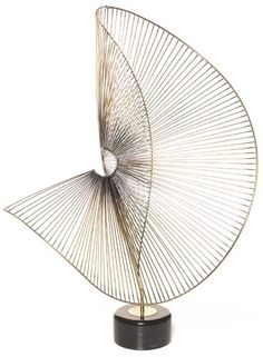 This design is by Naum gabo this is an interlocking design- This design has carefully been put together, adding the middle parts the design will become less flimsy. This image shows a strong structure