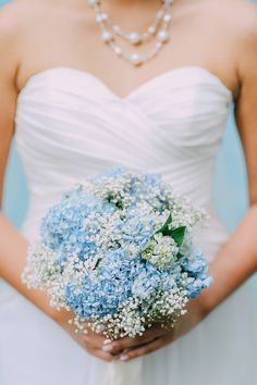 Blue hydrangeas and baby's breath bouqeut // Javen and Rhonda's Fresh and Fun Wedding at Resorts World Sentosa