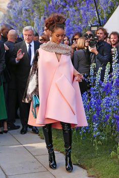 Rihanna - Swathed in a voluminous pink cape and wearing the OTK version of those It boots, Riri's look for the Dior show was fittingly regal.