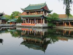 The Fish Watching Pavilion stands in the center of Green Lake Park in Kunming, Yunnan, China. Locals come to this park to hang out, play majiang, sing and dance. Green Lake Park, Kunming, Pavilion, Hanging Out, China, Fish, Dance, Play, Mansions