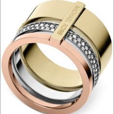Michael Kors Tri-Trio Stackable Ring This statement ring from Michael Kors effortlessly flaunts bright metallics and brilliant sparkle for trendy style. Crafted in rose gold tone, gold tone, and silver tone mixed metals. Size 8. NWT retail price $115. Michael Kors Jewelry Rings