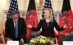 #HillaryClinton in Afghanistan wearing a Susanna Beverly Hills Famous Black Pantsuit. She looks her best in Susanna Beverly Hills designs. Susannabh.com