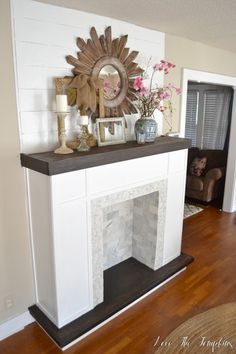 Faux fireplace made out of cardboard and styrofoam. Can you ...