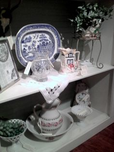 Blue and white is still in!Beautiful glassware and dishes.