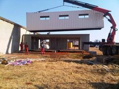 Cargo Container being placed on another Container unit.