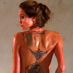 Angelina Jolie, I don't give a fuuuuck if this bitch is cliche. She's also fucking BAD ASS. Have you had ink given with a traditional manual needle??? BAD ASS.