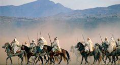 ELLE DECOR Goes to Marrakech...Moroccan horsemen in the desert outside the city.