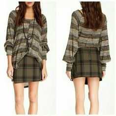 "Free People Bonded Plaid Mini Skirt This skirt is brand new. It is the Bonded Plaid Mini Skirt in Black/Taupe. It's cut from sturdy, brushed canvas. Serged edges and an uneven hem accentuate the faux wrap silhouette. Exposed back zip and lined. Made of 100% cotton. Tag size is 8. Total length is 14.5"". Free People Skirts Mini"
