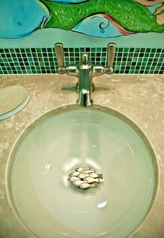decorative coastal drains for sink and shower